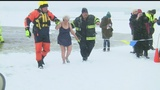 Community plunges into Mosquito Lake despite snowfall